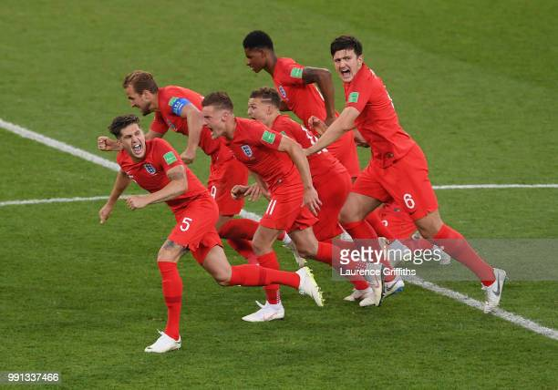 L-r John Stones, Harry Kane, Jamie Vardy, Kieran Trippier, Marcus Rashford, Harry Maguire and Jordan Henderson celebrate after Eric Dier of England...