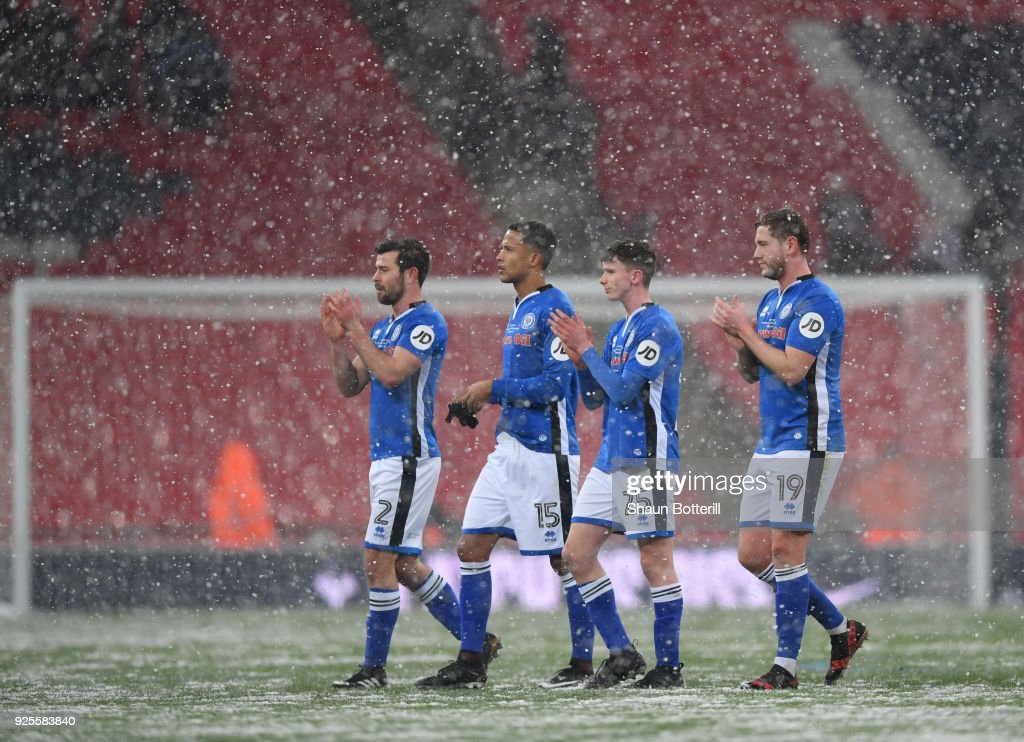 l-r Joseph Rafferty, Joseph Thompson, Daniel Adshead and Steven Davies of Rochdale walk off in the snow after the Emirates FA Cup Fifth Round Replay match between Tottenham Hotspur and Rochdale on February 28, 2018 in London, United Kingdom.