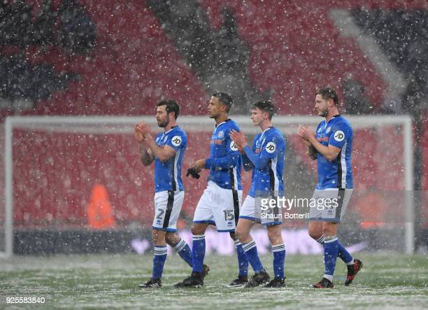 L-r Joseph Rafferty, Joseph Thompson, Daniel Adshead and Steven Davies of Rochdale walk off in the snow after the Emirates FA Cup Fifth Round Replay...