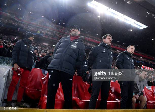 lr Jurgen Klopp Manager of Liverpool stands with Assistant Managers Peter Krawietz and Pepijn Lijnders ahead of the UEFA Champions League round of 16...
