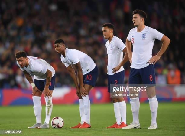 lr Kyle Walker Marcus Rashford Trent AlexanderArnold and Harry Maguire of England line up for a freekick during the International Friendly match...