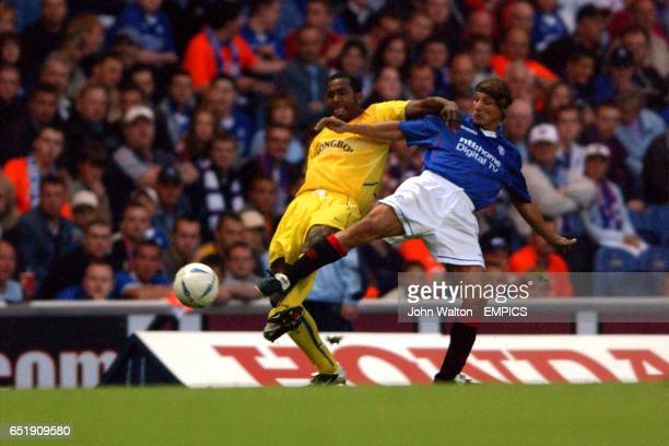 lr Leeds United's Lucas Radebe battles for possession of the ball with Rangers' Claudio Caniggia