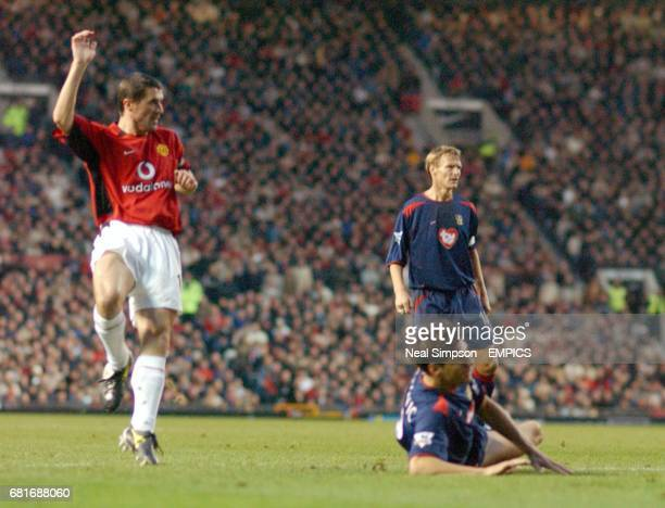 L-r; Manchester United's Roy Keane beats Portsmouth's Dejan Stefanovic to the ball to score their third goal