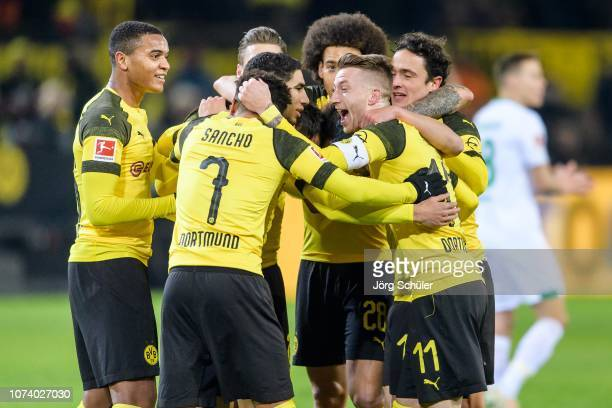 lr Manuel Akanji Jadon Sancho Marco Reus and Thomas Delaney of Dortmund react after the 10 lead during the Bundesliga match between Borussia Dortmund...