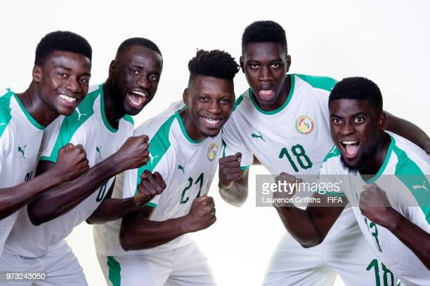 lr Moussa Wague Cheikhou Koyate Lamine Gassama Ismaila Sarr and Alfred Ndiaye of Senegal pose for a portrait during the official FIFA World Cup 2018...