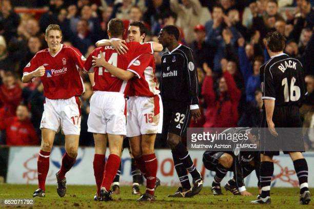 L-r Nottingham Forest's Michael Dawson, Chris Doig and John Thompson celebrate at the end of the game as Crystal Palace's Darren Powell and Tommy...