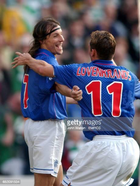 lr Rangers' Claudio Caniggia celebrates scoring the opening goal against Celtic with fellow goalscorer Peter Lovenkrands