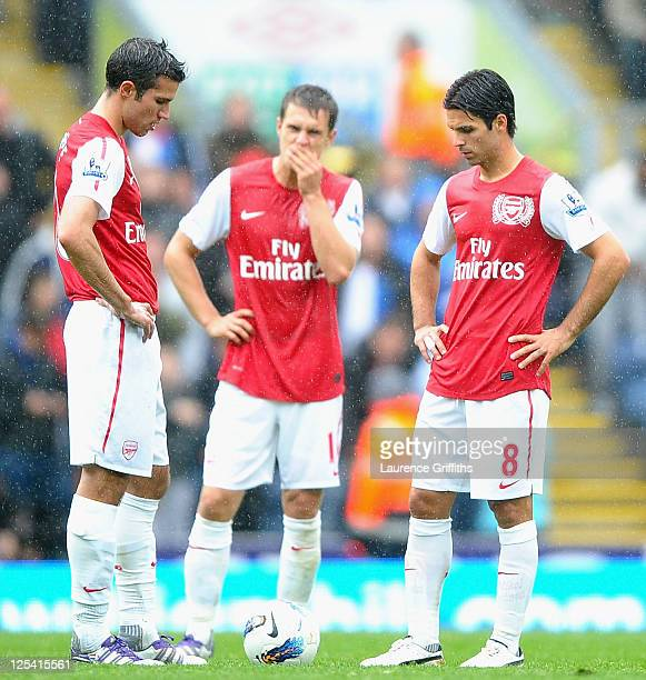 lr Robin Van Persie Aaron Ramsey and Mikel Arteta of Arsenal show their dissapointment after the fourth goal during the Barclays Premier League match...