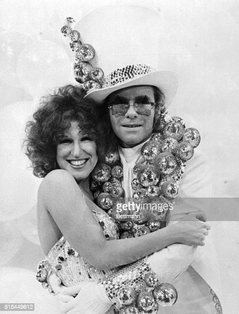 Rock star Elton John is shown embracing singer Bette Midler on the set of the Cher TV show on CBS Both are wearing outlandish costumes