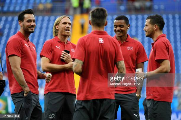 lr Roman Buerki Michael Lang Manuel Akanji and Remo Freuler of Switzerland looks on during a pitch inspection prior to the 2018 FIFA World Cup Russia...