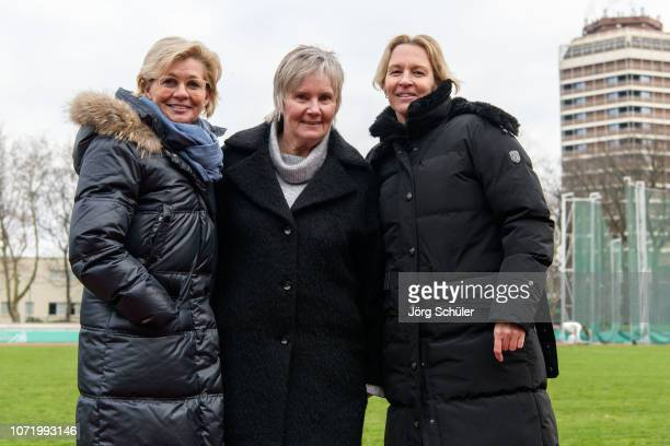 lr Silvia Neid Tina Theune and national coach Martina VossTecklenburg pose for a photo after the U17 Girl's international friendly match between...