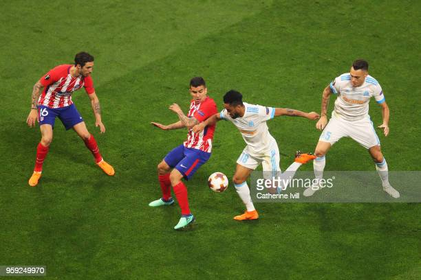lr Sime Vrsaljko and Angel Correa of Atletico Madrid compete for the ball with Jordan Amavi and Lucas Ocampos of Marseille during the UEFA Europa...