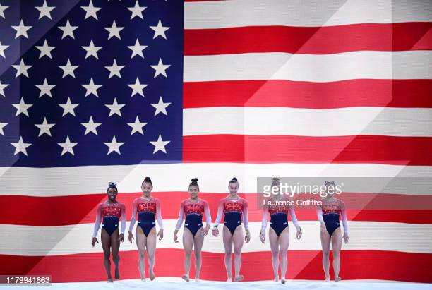 lr The USA Team enter the Arena for the Women's Team Finals on Day 5 of FIG Artistic Gymnastics World Championships on October 08 2019 in Stuttgart...