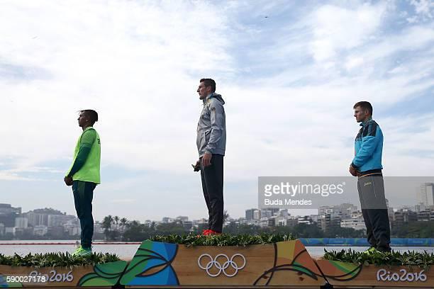 Russia] Silver medalist Isaquias Queiroz dos Santos of Brazil gold medalist Sebastian Brendel of Germany and bronze medalist Serghei Tarnovschi of...