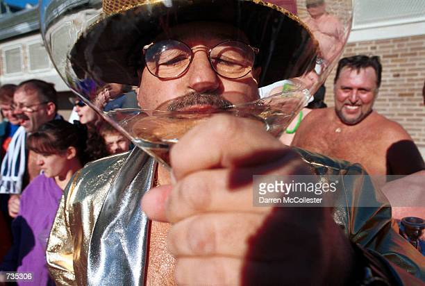 Street Brownie member Chico Malkofsky takes a drink of champagne January 1 2001 prior to his annual New Year's day swim in Boston Harbor in Boston MA...