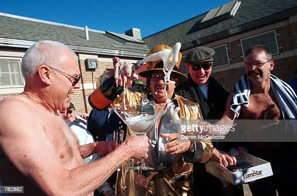 Street Brownies member Chico Malkofsky and Jimmy O''Connor left drink champagne January 1 2001 prior to their annual New Year's day swim in the...