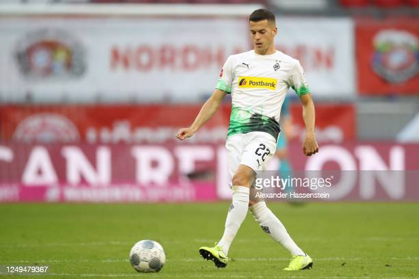 László Bénes of Borussia Moenchengladbach runs with the ball during the Bundesliga match between FC Bayern Muenchen and Borussia Moenchengladbach at...