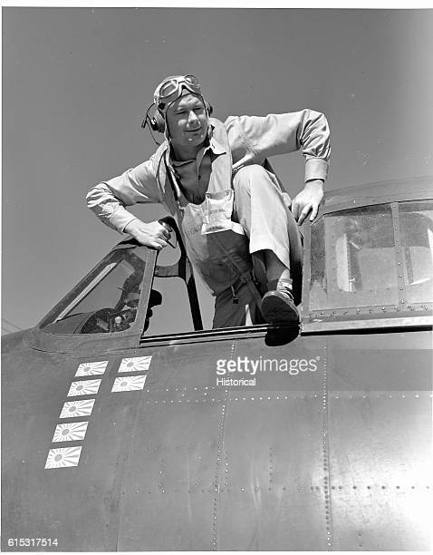 Lt Cdr Paul D Buie climbs from the cockpit of his F6F on board the USS Lexington He has just returned from intercepting the enemy on the Marshalls...