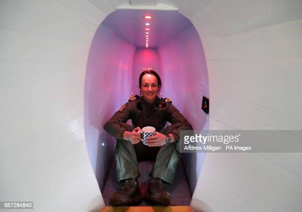 Lt Cdr Serena Davidson enjoys a cup of tea in the tail fin of a converted former Navy Sea king MK6 helicopter during a visit to see it at its new...