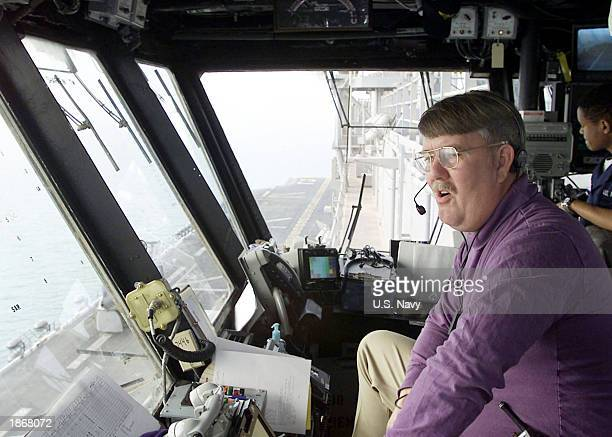 S Lt Cmdr Jim Mcdowell from Virginia Beach Virginia the MiniBoss aboard the amphibious assault ship USS Saipan directs aircraft from his station at...