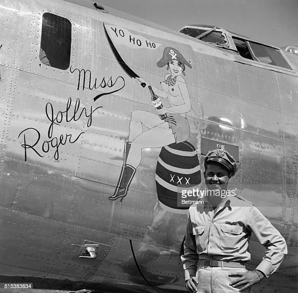 Lt Col Edward W Scott Jr Hollandale Mississippi newly assigned to the famous Jolly Rogers unit stands before his new B24 Liberator Miss Jolly Roger...
