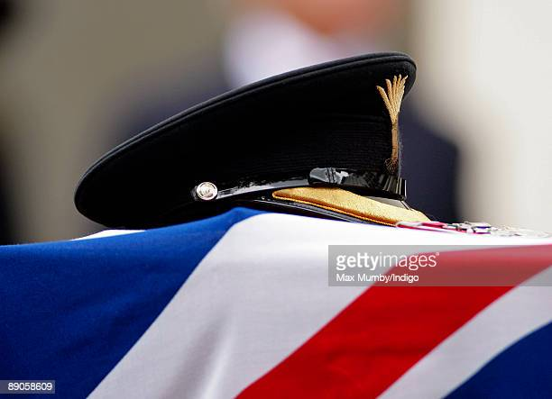 Lt Col Rupert Thorneloe's cap rests on his coffin at his funeral at The Guards Chapel on July 16, 2009 in London, England. Lt Col Thorneloe...