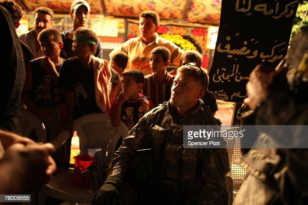 Lt Col Steven Miska the Deputy Commander for the Dagger Brigade Combat Team First Infantry Division speaks with religious Shia pilgrims while on a...
