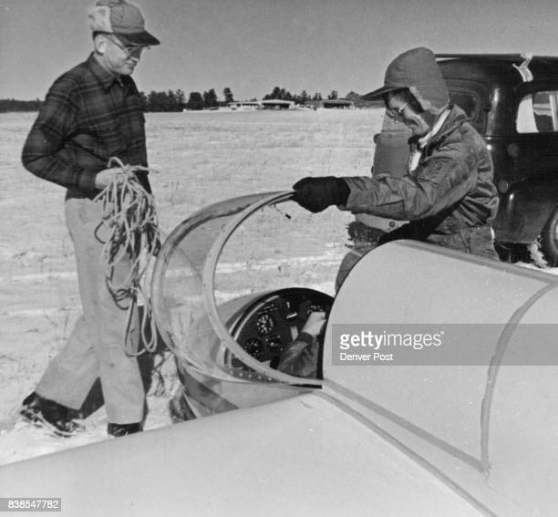 Lt Col W C Wiley of Albuquerque N M and Anne Burns of England help her husband Denis Burns prepare for wave flight in Wiley's plane Credit Denver Post