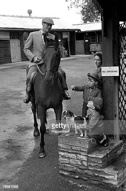 1953 Lt Colonel Harry Llewellyn pictured on his horse with his wife and their sons David and Roddy at their stables Gobin Manor Abergavenny Wales