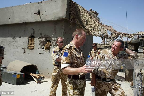 Lt. Colonel Joe O'Sullivan, Commanding Officer of the 2nd Battalion The Parachute Regiment talks to Liutenant General Sir John Nicholas Houghton KCB,...