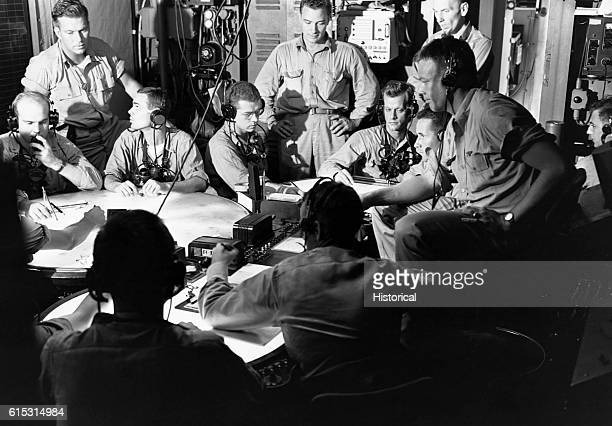 Lt Commander AF Fleming fighter director plans strategy with his staff in the plot room of the USS Lexington on November 19 during a strike in the...