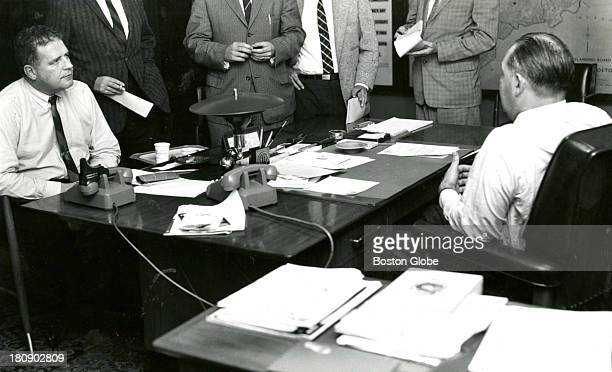 Lt Detective John Donovan of the Boston Police homicide department meets with Commissioner Edmund McNamara about a new suspect in the recent...