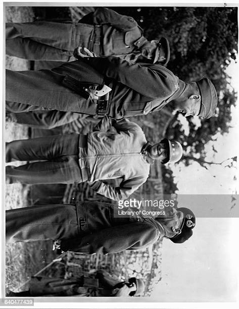 Lt. Gen. George S. Patton, Lt. Gen. Omar N. Bradley, and General Sir Bernard Montgomery, meet to discuss the progress of the French campaign,...