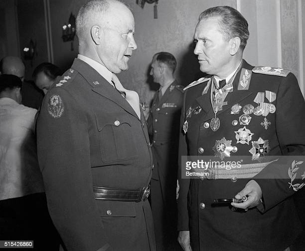 Lt Gen John CH Lee Commanding General Mtousa has a serious conversation with Marshal Tito attired in dress uniform and many medals during a reception...
