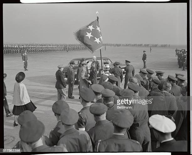 Lt Gen Matthew Ridgway bids farewell to Gen Douglas MacArthur at Haneda Airport just before the General and his party boarded his plane the Bataan...