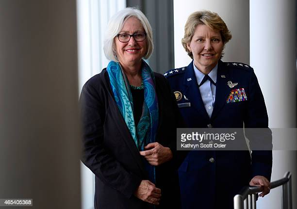 Lt Gen Michelle DJohnson right and Dr Terry Odendahl are honored at the WorldDenver International Women's Day celebration for their contributions to...