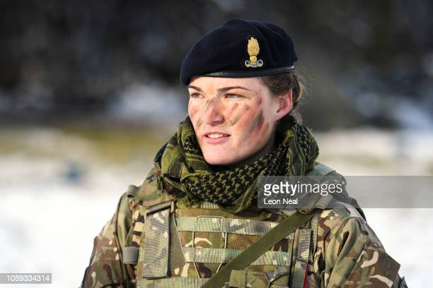 Lt George from the Royal Engineers, a corps of the British Army, speaks to a colleague as she takes part in pre-exercise integration training on...