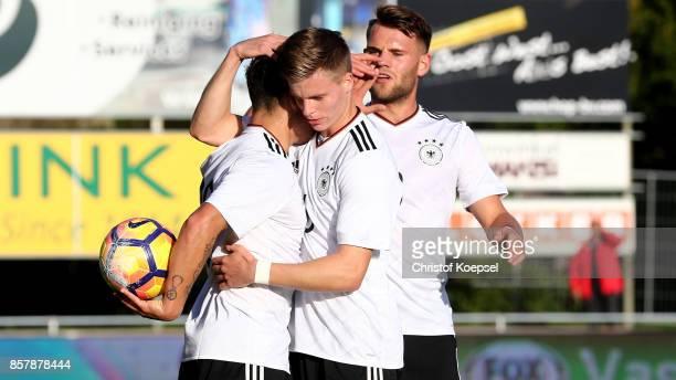#lt Goerkem Saglam of Germany celebrates the first goal with Dzenis Burnic and Eduard Loewen during the International friendly match between U20...