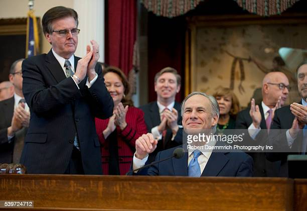 Lt Gov Dan Patrick applauds as Texas Governor Greg Abbott r gives his first State of the State speech since becoming governor after Rick Perry's 2014...