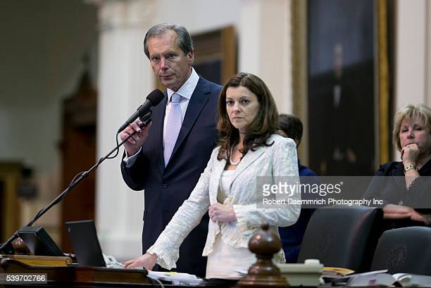 Lt Gov David Dewhurst and Senate Parliamentarian Karina Davis listen to debate as political drama unfolded at the Texas Capitol in the last hour of...