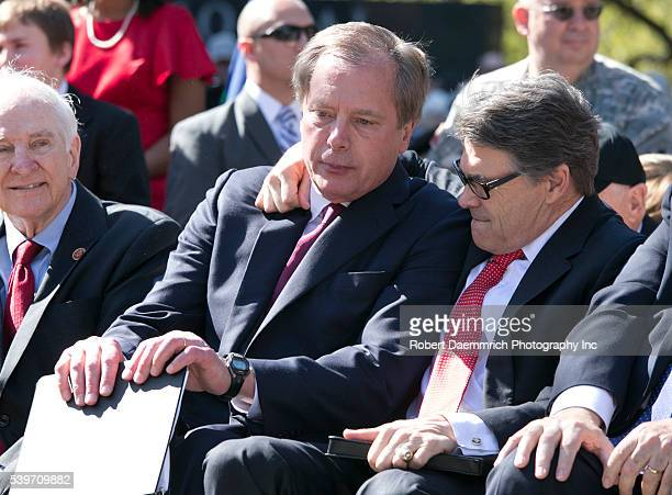 Lt Gov David Dewhurst l and Texas Gov Rick Perry embrace as thousands of Texans turn out for the Texas Capitol Vietnam Veterans Momument dedication...