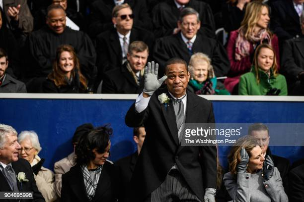 Lt Gov Justin Fairfax waves after taking the oath of office during inauguration on Saturday January 13 at the Virginia State Capitol in Richmond VA