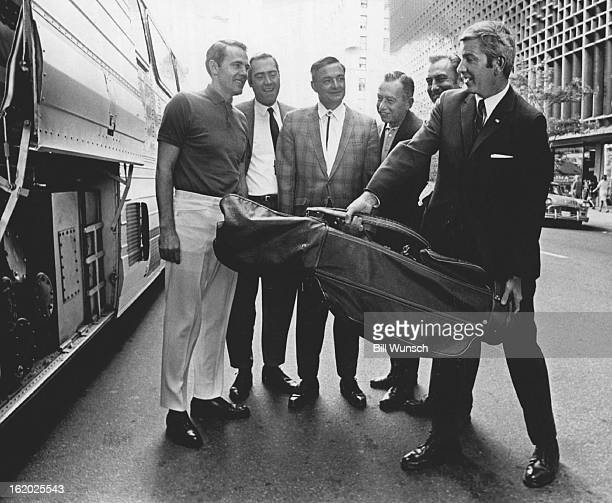 JUN 25 1969 Lt Gov Mark Hogan of Colorado Helps Load Golf Clubs Onto Bus For Trip to Hiwan Country Club With him are from left Lt Govs Ray Osborne of...