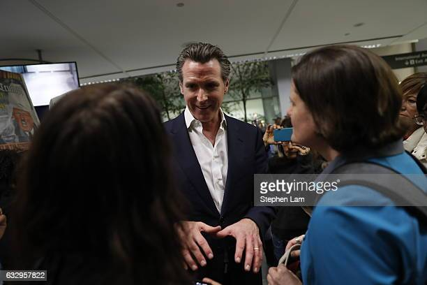 Lt Governor of California Gavin Newsom speaks to demonstrators during a rally against a ban on Muslim immigration at San Francisco International...