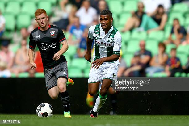 #lt Harrison Reed of Southampton challenges Juninho Bacuna of Groningen during the friendly match between FC Groningen an FC Southampton at Euroborg...