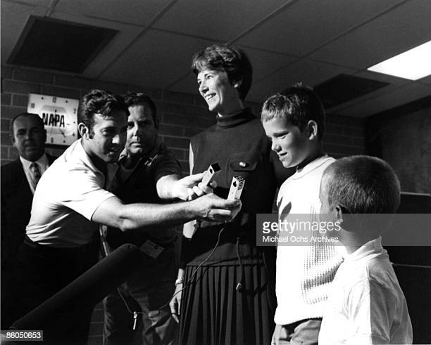 Lt Jane Armstrong wife of astronaut Neil Armstrong and their children Eric and Mark talk to newsmen as they await the lift off at the Spaceport's...