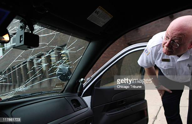 Lt John Andrews watch commander at the 11th district Chicago Police department shows the damaged caused by hail on a new police car outside the area...