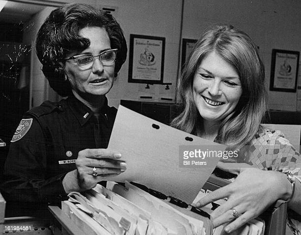 JUL 28 1971 JUL 29 1971 AUG 18 1971 Lt Mary Norris and detective Julie Williamson center The Commerce City police officers are discussing a juvenile...