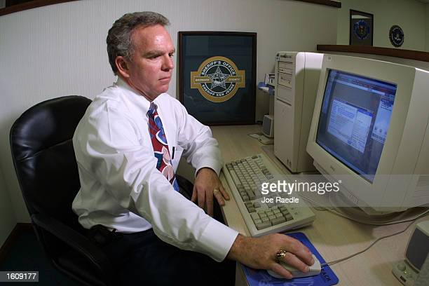 Lt Paul O''Connell from the Broward County Sheriff''s Office uses an AOL account on his computer August 14 2001 to bring online pedophiles to justice...