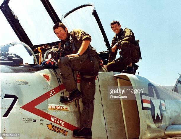 Lt Randall Cunningham pilot and LtJG William Driscoll Radar Intercept Officer prepare to enter the cockpit of an F4J Phantom II figher Viet Nam 1972...